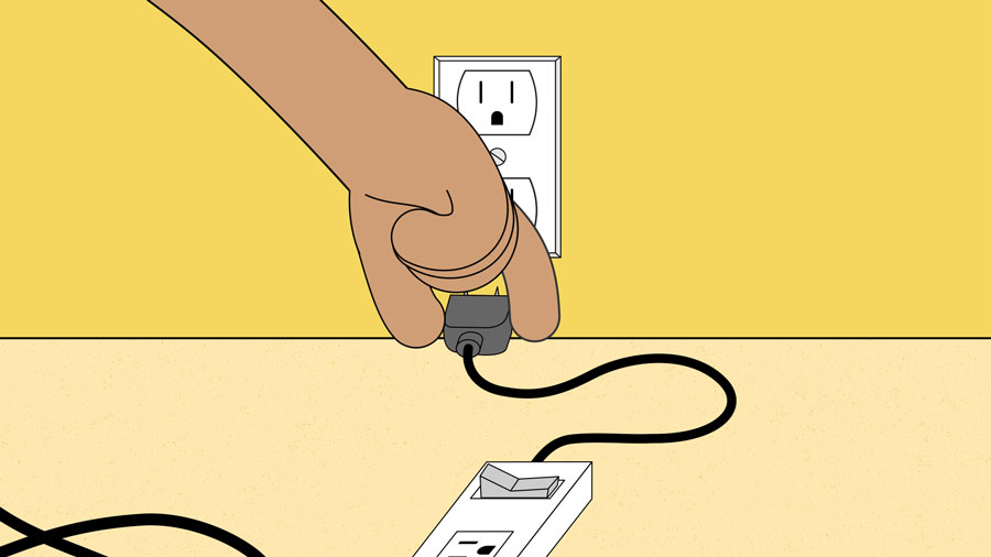 plugging the surge protector into the wall
