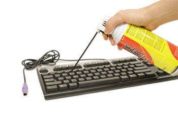 cleaning the keyboard with compressed air