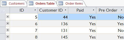 The Customer ID field links to the Customers table