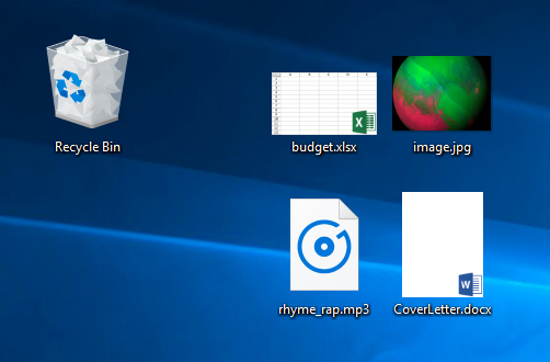 several files on the desktop, showing file extensions