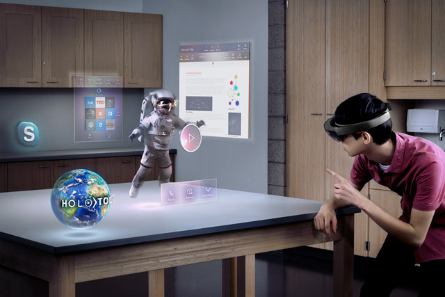 A man uses a Hololens device at home.