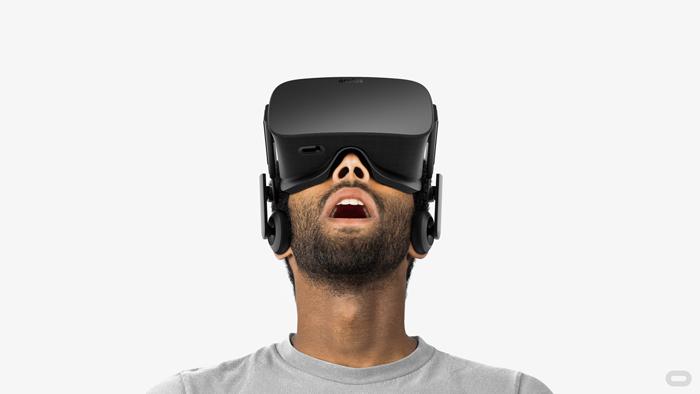 A man looks through a virtual reality headset.