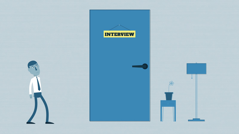 A job applicant pausing in front of an employer's office door.
