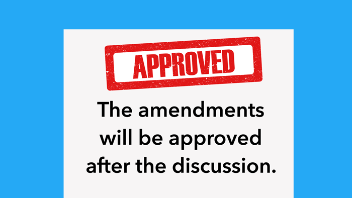 """A document stamped with the word """"Approved"""", containing the following text: """"The amendments will be approved after the discussion""""."""