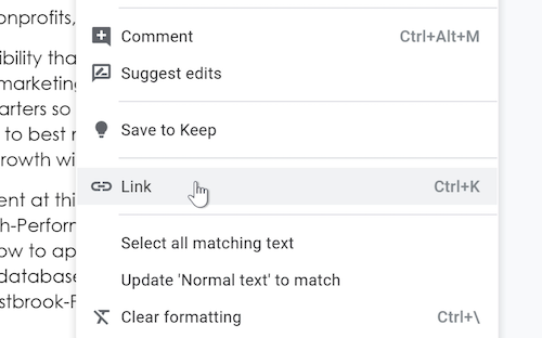 A cursor hovers over the Link option within the Insert drop-down menu.