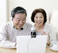 Couple using a webcam and headset